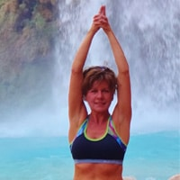 donna foster in yoga pose near waterfall